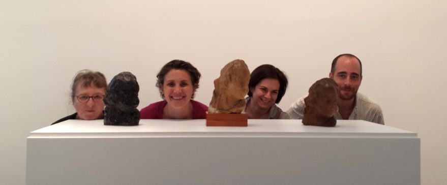 """Scholars Elisabeth LeBon, Francesca Brewer, Sharon Hecker, and Austin Nevin during their two-day study period preceding the opening of """"Medardo Rosso: Bambino ebreo"""" at Peter Freeman, Inc., New York (June 2014) (not pictured: Henry Lie). The sculptures in the foreground are all casts of Rosso's Bambino ebreo (1892-92); from the left: a plaster cast in the collection of the Museo Medardo Rosso, Barzio, Italy; a wax cast in a private collection; and a wax cast in the collection of the Nasher Sculpture Center, Dallas."""