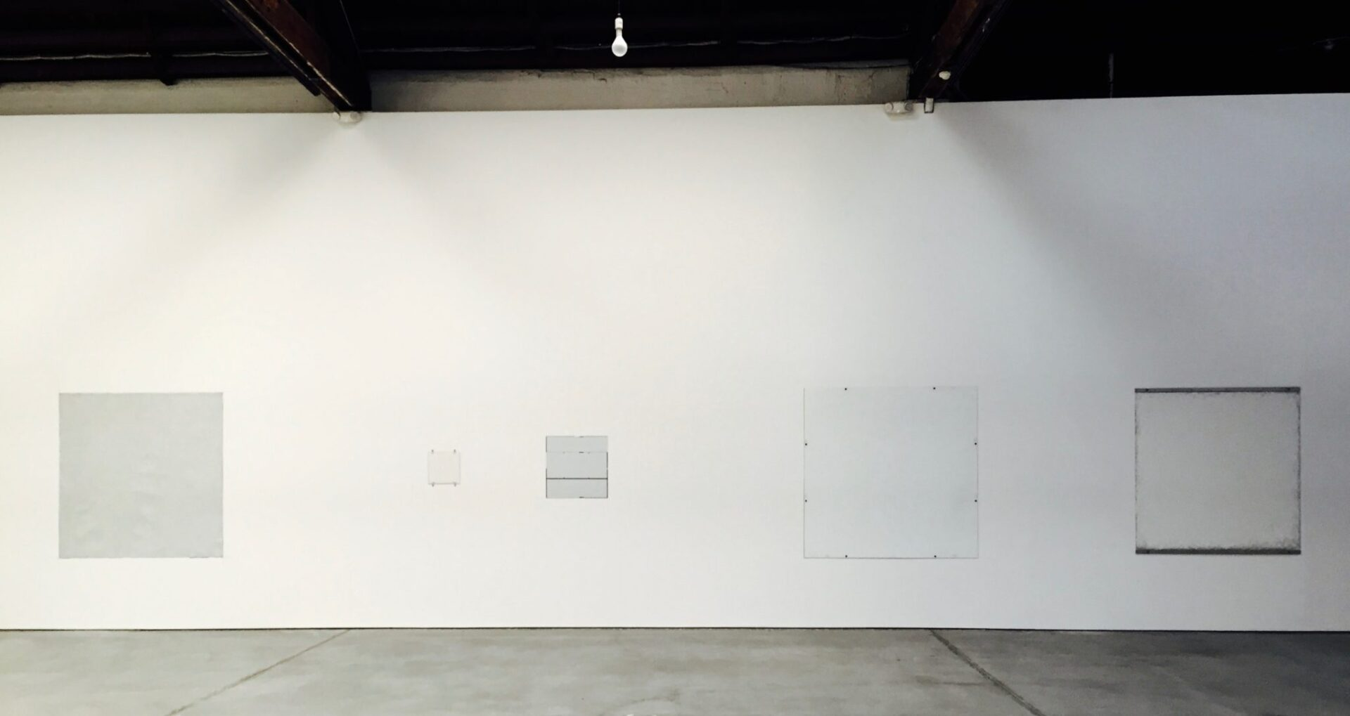 Robert Ryman. Gallery 2, installation view of the east wall. This selection of works ranging from 1968 to 1985 demonstrates Ryman's interest in industrial materials as supports for his paintings, including Plexigas and aluminum.