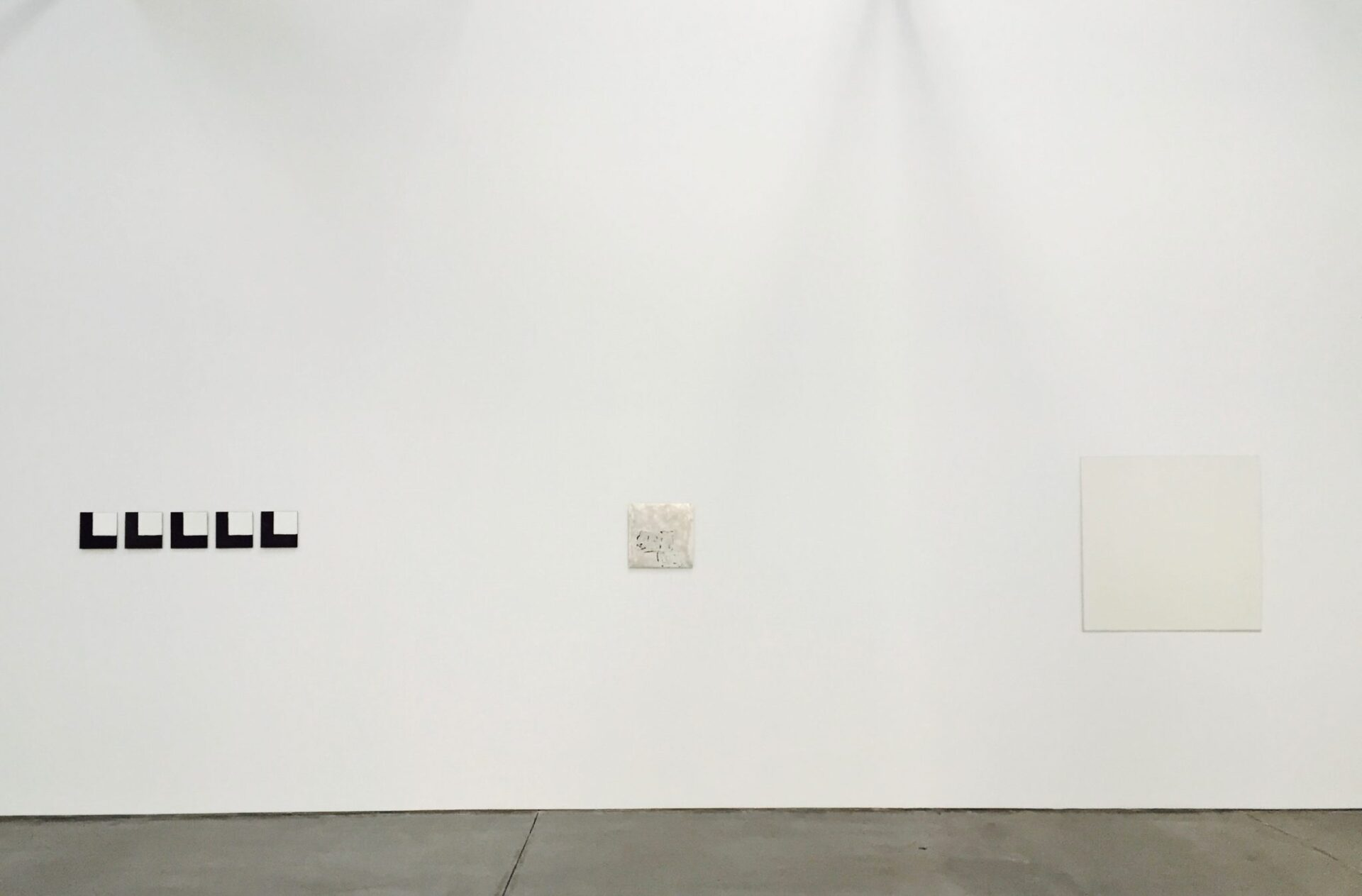 Robert Ryman. Gallery 2, installation view of the south wall. Ryman used manifold ways of distributing paint on a surface, including firing. The work on the left, Untitled, 1973, consists of double-baked vitreous enamel on oxidized copper.