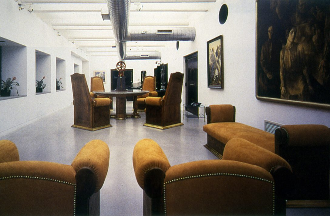 The second floor lobby, with furniture from the train station. Photo by Wolfsonian-FIU.