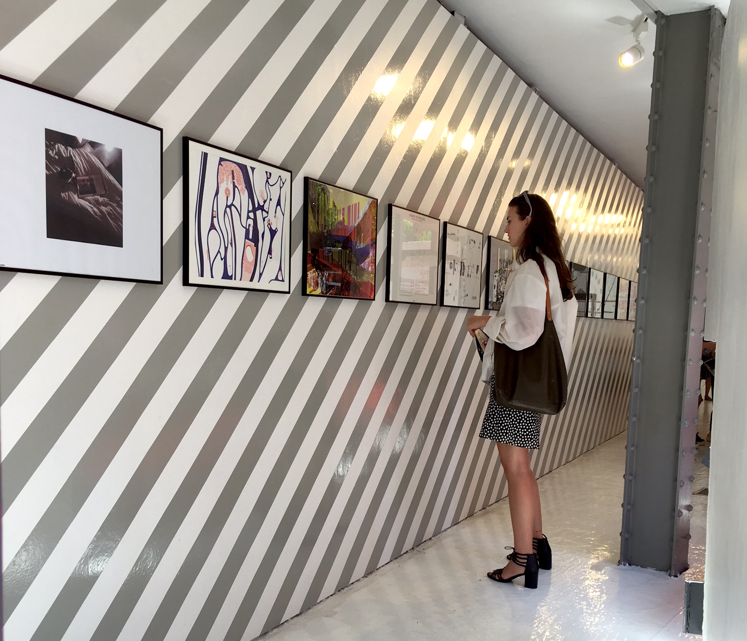 Installation view: Anna Mahony contemplates architecture renderings